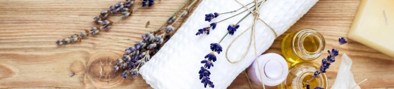white-towel-lavender-flowers-oils-candle.jpg