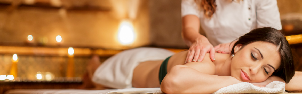 woman-massage-services-candles.png