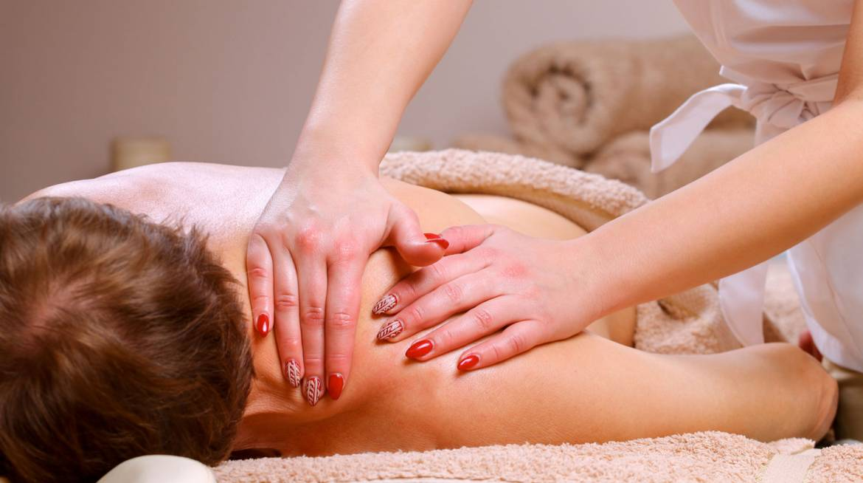 man-massage-deep-tissue-woman-red-nails.jpg