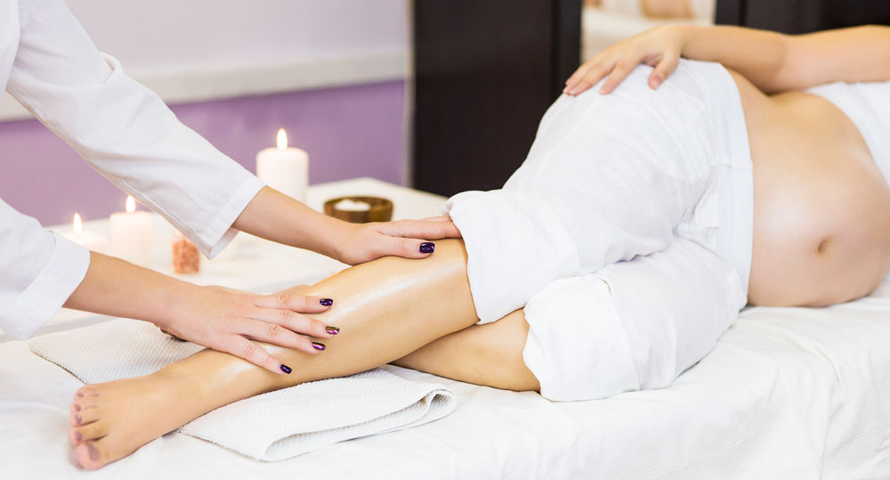 pregnant-woman-getting-leg-massage.jpg