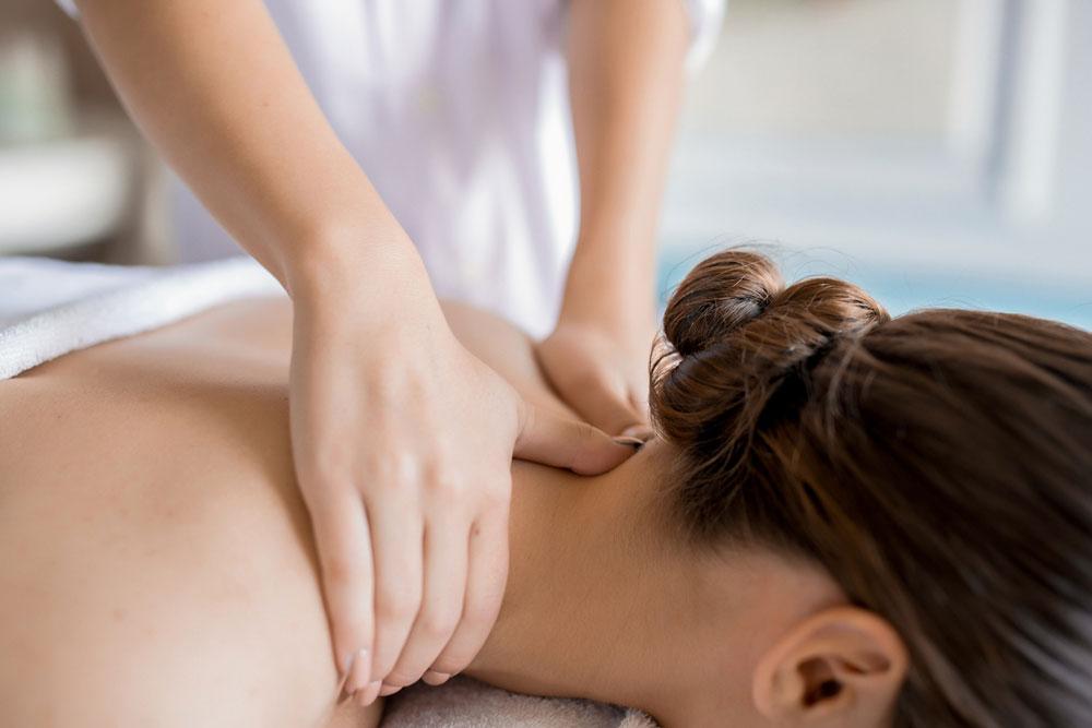 woman-neck-massage-therapy-kelly-erceg.jpg