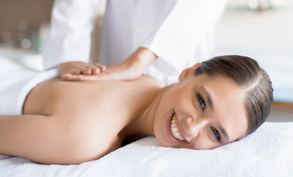 woman-smiling-getting-back-massage-therapy.jpg